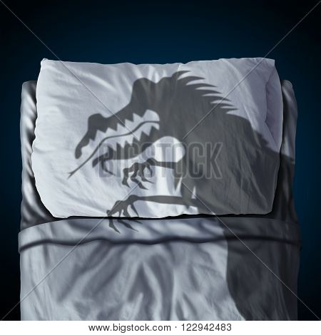 Nightmare and scary night dream concept as a cast shadow of a creepy monster on a bed with a pillow on a mattress as a symbol of childhood sleep anxiety or bedtime stress.