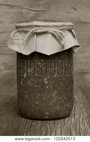 tomato sauce with sweet pepper in glass jar closeup. home canning. black and white photo