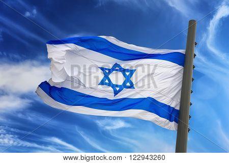 The Israeli flag against the blue sky