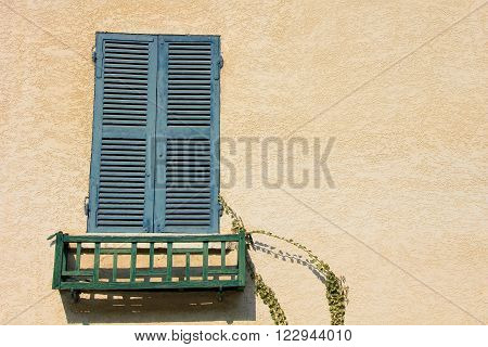 window with blue, closed shutter in france ** Note: Soft Focus at 100%, best at smaller sizes