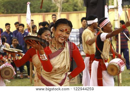 JORHAT, ASSAM/ INDIA – MARCH 21: A dancer performs traditional Bihu Dance . The Bihu dance is a folk dance from the Indian state of Assam related to the Bihu festival. This joyous dance is performed by both young men and women and is characterized by bris