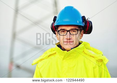 Worker wearing reflective clothing with blue helmet
