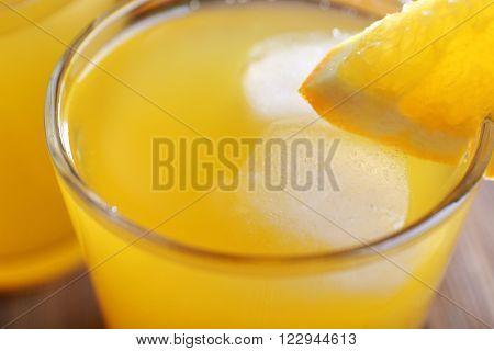 Orange juice with ice and orange, closeup