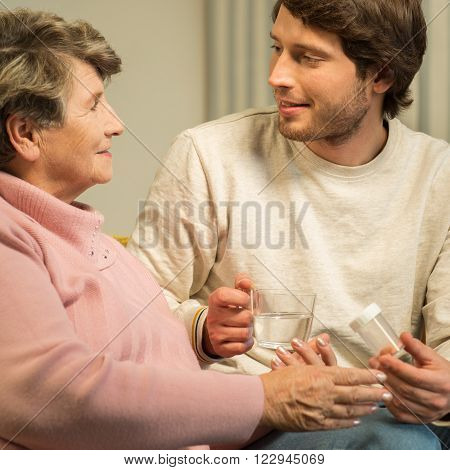 Senior Woman Talking With Caregiver