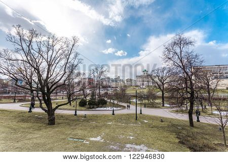 Moscow, Russia - March 20, 2016: Average garden of the Alexander Garden near walls of the Kremlin at the beginning of spring.