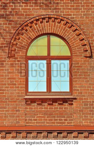 Window with an arch on the background wall of red brick. From the series window of Saint-Petersburg.