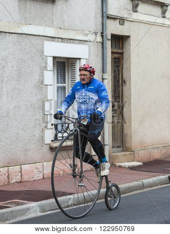 Vendome France- March 7 2016:A man rides a velociped on the streets of Vendome during the first stage of Paris-Nice 2016.