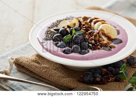Blueberry smoothie bowl with banana, chocolate syrup and chia seeds