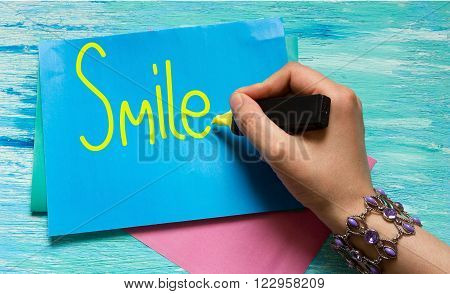 Smile word Inspirational quote handwritten with black ink and brush custom lettering for posters t-shirts and cards. Vector calligraphy isolated on white background Hand lettering.
