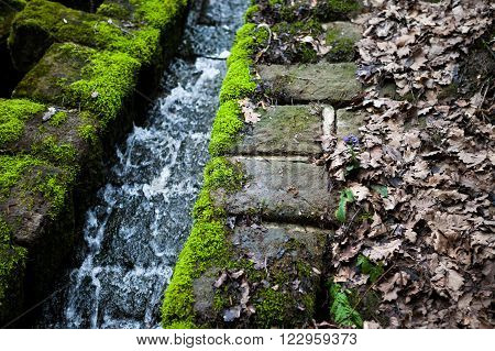 Water flowing through an old historical drainage canal