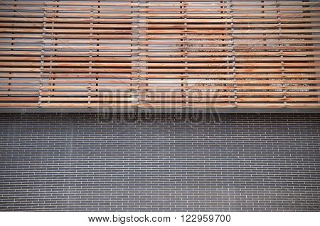 Brickwork and wooden facade. Symmetrical background. Empty copy space for editor's text.