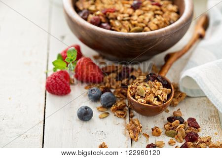 Homemade granola with milk and fresh berries for breakfast