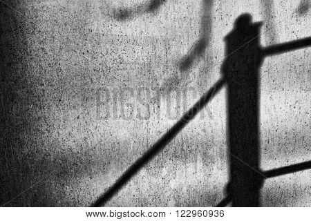 Abstract shadows on a painted metal surface