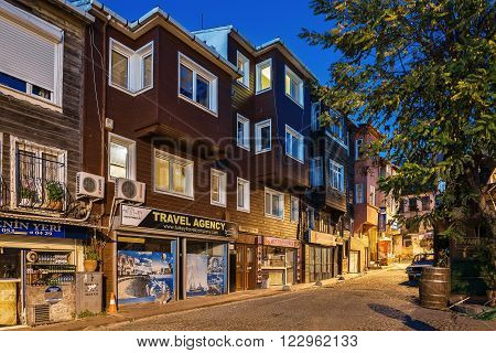 ISTANBUL , TURKEY - November 18, 2013: Apartments Sultanahmet. The old wooden house on a narrow street in area Sultanahmet.