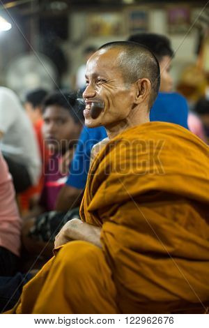 WAT BANG PHRA, THAILAND - MAR 19, 2016: Unidentified monk master Yantra Tattoos during Master Day Ceremony at Bang Phra monastery, about 50 km west of Bangkok.