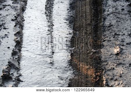 Tire tracks in thick fresh mud