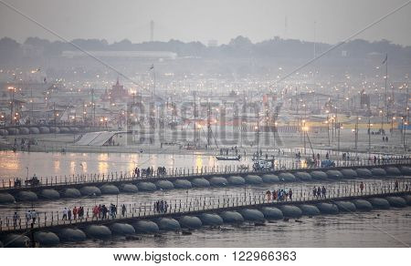 ALLAHABAD, INDIA - FEBRUARY 06, 2013: Thousands of Hindu devotees crossing the pontoon bridges over the Ganges River at Maha Kumbh Mela festival in Allahabad, India