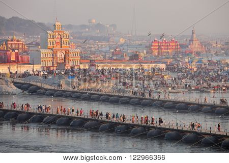ALLAHABAD, INDIA - FEBRUARY 08, 2013: Thousands of Hindu devotees crossing the pontoon bridges over the Ganges River at Maha Kumbh Mela festival in Allahabad, India