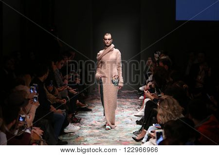 ISTANBUL, TURKEY - MARCH 18, 2016: A model showcases one of the latest creations of Bashaques in Mercedes-Benz Fashion Week Istanbul