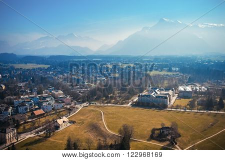 View on empty city and far hills, mountains. Panoramic view on snow mountain, Salzburg, Austria, Europe.