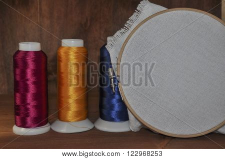 wooden hoop and canvas for cross pattern embroidered