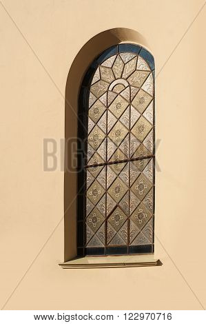Window in an old architectural building in the classical style.