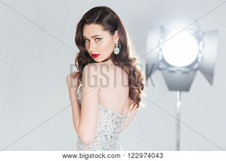 Charming woman in fashion dress looking at camera
