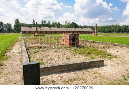 Auschwitz II - Birkenau, Block 22 ruins and what's left of the heating stoves, at Sector II, with the kitchen in the background