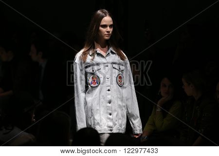 ISTANBUL TURKEY - MARCH 18 2016: A model showcases one of the latest creations of Salih Balta in Mercedes-Benz Fashion Week Istanbul