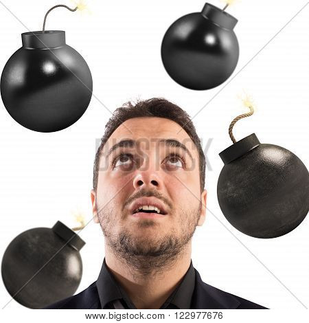 Man with worried expression with bombs falling