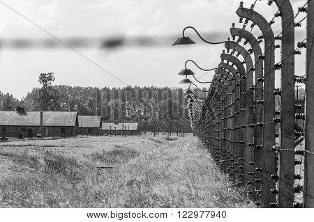 OSWIECIM, POLAND - JULY 3, 2009: Auschwitz II - Birkenau aspect of the electrified barbed wire fence