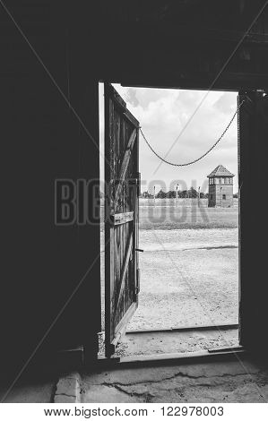 OSWIECIM, POLAND - JULY 3, 2009: Auschwitz II - Birkenau view of a watch tower from inside on of the barracks at Sector II