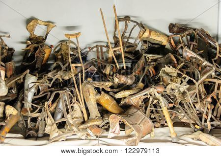 OSWIECIM POLAND - JULY 3 2009: Auschwitz I - Birkenau prosthetics collected from prisoners exhibited in Block 5 as Material Evidence of Crimes commited