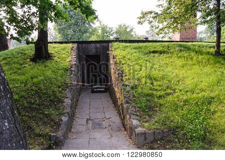 OSWIECIM, POLAND - JULY 3, 2009: Auschwitz I - Birkenau Crematorium I back entry that was installed when used as an air raid shelter, and was not present when the building was used as a gas chamber and crematorium