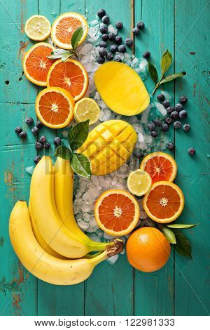 Ingredients for a tropical fruit smoothie with mango and banana