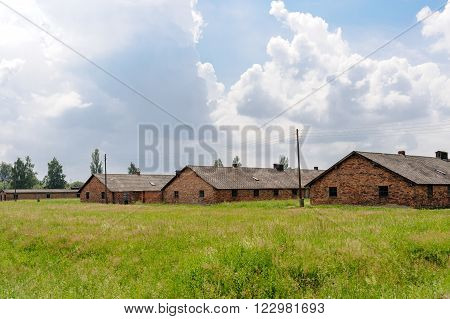 OSWIECIM, POLAND - JULY 3, 2009: Auschwitz II - Birkenau, barracks Blocks 25, 26 and 27 of Sector I