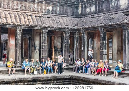SIEM REAP CAMBODIA - MARCH 08: Tourists visitors Angkor Wat is the country's prime attraction is the largest Hindu temple and religious monument in the world on March 08 2016 Siem Reap Cambodia.