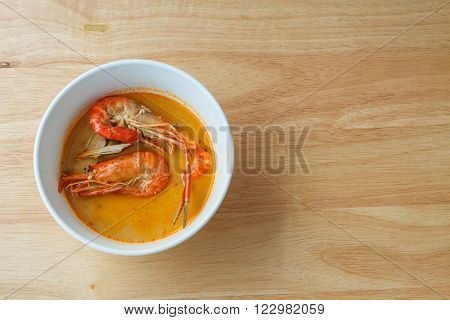Thai spicy soup shrimp, Bowl of spicy Thai Tom Yum Soup on wooden background