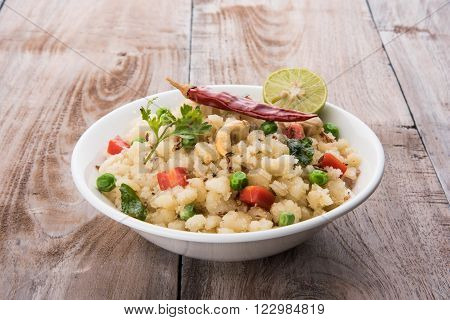 Rava Upma - Popular south Indian breakfast wiih semolina and vegetables, selective focus, Upma or upama is a South Indian breakfast, cooked from dry roasted semolina. seasonings of vegetables ** Note: Shallow depth of field