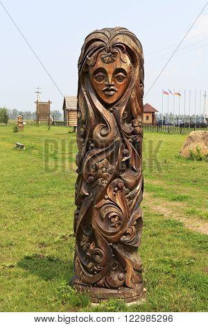 Novotyryshkino, Russia - July 31, 2013: Wooden sculptures based on Pushkin's fairy tales. Tourist Complex Siberian Podvorye.