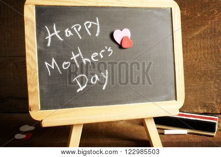 A vintage style of a mothers day announcement using a chalkboard.