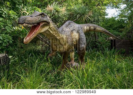PERTH, WA / AUSTRALIA - MARCH 13: Roaring Baryonyx standing in tall grass display model in Perth Zoo as part of Zoorassic exhibition in March 2016