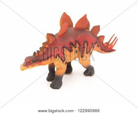 side view red stegosaurus toy on a white background