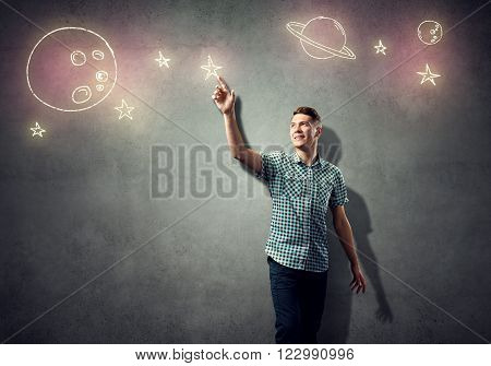 Concept of dreaming businessman with drawn elements of space