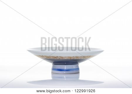 Asian ceramics cups on white with reflection Clipping path