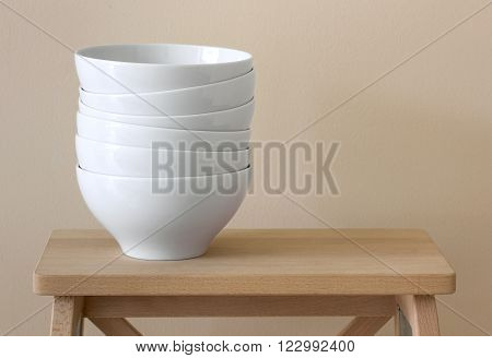 stack of white bowl on wood table