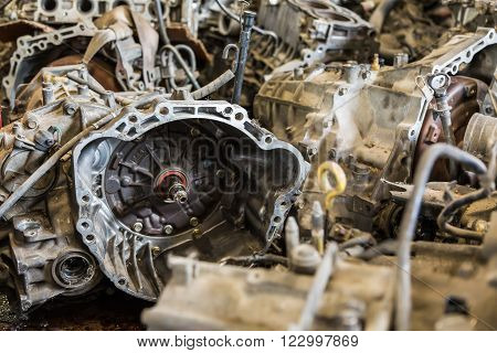 Scrapheap of old car automatic transmission and car engine