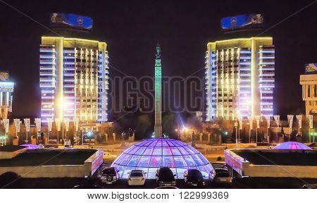 ALMATY KAZAKHSTAN - MARCH 23 2016: Night view of Monument of Independence of Kazakhstan. Monument was inaugurated on Republic Square December 16 1996.