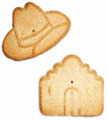 Sugar Cookies In Symbols Of Texas: Cowboy Hat And Alamo Over White Background