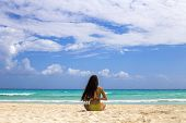 Woman meditating at the beach in a yoga retreat. Playa del Carmen, Mexico. poster